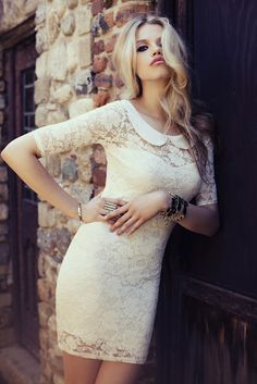 White lace body con dress with peter pan collar. They just took my 3 favorite things and put them together.