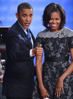 Michelle Obama's Campaign Style 2012: Take note — even the First Lady repeats her outfit and within a month of each other. We first saw her wear this gray-and-black lace Thom Browne sheath at the DNC, and last night, she refreshed her look by adding a wide black waist belt and a crystal-encrusted bow pin at the neckline.
