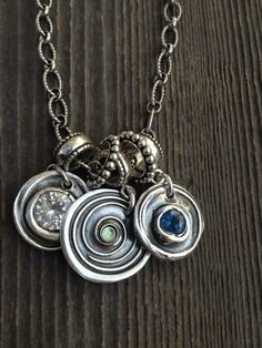 Mother's Day Treasures.... Birthstone jewels in fine and sterling silver wax seal pendants.... Soldered back tags holds name or dates... LOVE!