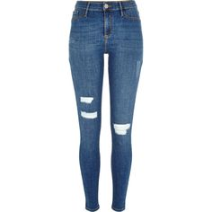 Checkout this Mid wash ripped Molly jeggings from River Island