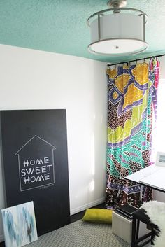 I really like the ceiling color and the bright white walls with the fun curtains... it's an idea...