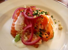 Smoked salmon with avocado, creme fraiche and pickled onions at The Richmond, Hackney