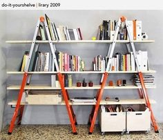 DIY Ladder Bookshelves  To get this look, all you need are two ladders and some wood planks. Paint the ladders and the wood if you want, then slide the wood planks through the ladders so they are resting on the ladder steps.