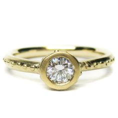 Organic Engagment Ring    14k yellow gold and 0.28ct round brilliant diamond Roman ring      $4285