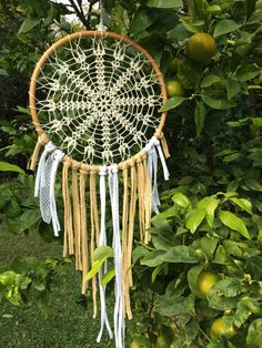 Bohemian dream catcher, stunning and beautiful wall hanging. Perfect bohemian touch for your living room or stunning garden decor for a boho summer wedding. Nature inspired look that suits nearly any space. Each crochet doily is unique, hand made and one of kind, M size natural