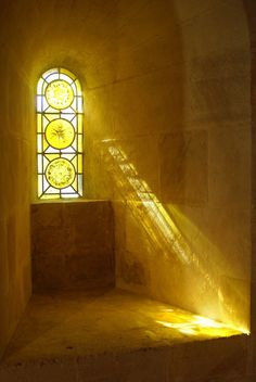 sunlight through stained glass window
