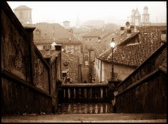 Mist over the old town by marilenavaccarini