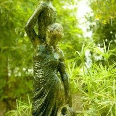 Moss-covered statues invite visitors to your garden.