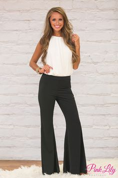 We are loving the retro vibe from this gorgeous pair of pants! Featuring a classic black color paired with a flared bell-bottom style, it's a beautiful way to combine modern style with a vintage touch!