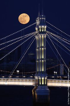 LONDON:  Full Moon Rises Over Albert Bridge In London