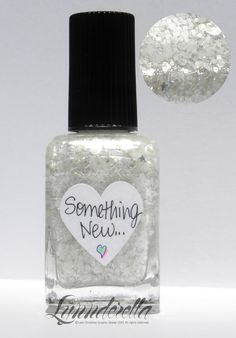 Lynnderella Limited Edition —  Something New... is the third in a series of four new bridal-themed lacquers. It contains assorted whites accented with tiny silver holographic stars and rainbow dust in a white- and pink-shimmered clear base.