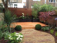 Sleeper and gravel steps sleeper retaining wall steps for Garden decking north london