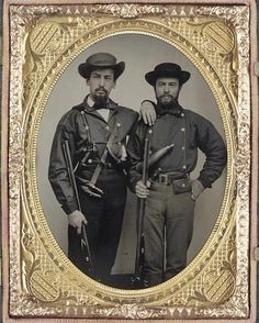 """Two unidentified soldiers in Mississippi battle shirts with double barrel shotguns, knives, and powder horns,"""" hand-colored ambrotype. @LibraryCongress #CivilWar #History"""