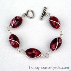 Wire-Wrapped Bead Bracelet..I really want to try this. Its so pretty.