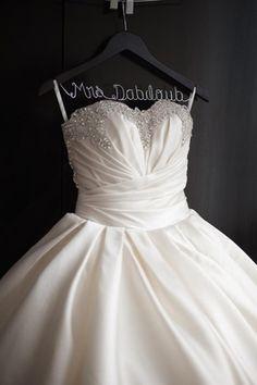 Sparkling Pnina Tornai ball gown on custom Mrs. hanger | Nancy Ray Photography