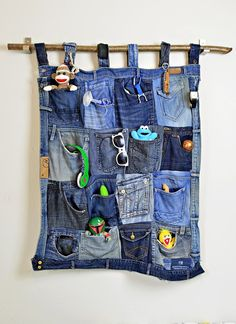 The Best Upcycled Denim Crafts & DIY Why not recycle your old jeans into something fabulous. Denim is a fantastic fabric to upcycle with, here are some of the best denim crafts and DIY's to inspire you. Wall Pocket Organizer, Hanging Organizer, Hanging Storage, Fabric Organizer, Diy Organizer, Diy Hanging, Artisanats Denim, Denim Purse, Denim Pants