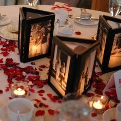 Glue 3 picture frames together with no backs, then place a flame less candle inside to illuminate the photos.
