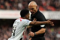 Arsenal 2 1 Liverpool in the FA Cup, and Raheem Sterling lives dangerously by pushing referee Howard Webb.