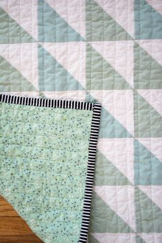 Mint and White Half Square Triangle Quilt by The Neverending Bobbin