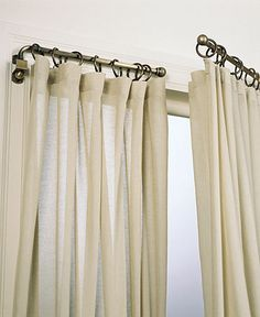 Way cool curtains, especially for the black out blinds in the summer in kids room, close them when its bedtime and open during day for the light. I WANT!!