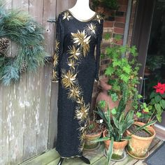 Vintage evening dress KILLER STUNNING, DROP DEAD GORGEOUS vintage evening gown. Sequin Imports Unlimited. 100% pure silk. 100% rayon lining.  The beading is lovely and in good condition except for a few missing black beads on the front as seen in picture. Gold beading all the way around the bottom with slit in the back.  I just love the open back! Vintage Dresses