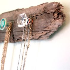Make a necklace organizer using found knobs and driftwood.