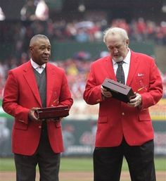 St. Louis Cardinals Hall of Famers Ozzie Smith, left, and Bruce Sutter examine their 2011 World Series championship ring before a baseball game between the St. Louis Cardinals and the Chicago Cubs, Saturday, April 14, 2012 in St. Louis.: