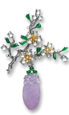 Brooch: Multi-Colored Jadeite, Yellow Diamond & Diamond. Modeled as a branch of peach blossoms, set w/21 translucent icy jadeite cabochons & 12 jadeite cabochons of emerald green color, embellished by yellow diamonds & diamonds, suspending on a translucent lavender jadeite, carved as a peach with a monkey atop, mounted in 18 karat blackened and white gold, pendant detachable.