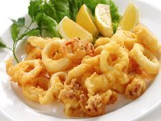 Fried Calamari Antipasto, an Authentic Italian Recipe from our kitchen to yours. An enticing antipasto with light and crispy fried calamari you won't be able to resist! Greek Recipes, Fish Recipes, Seafood Recipes, Italian Recipes, Greek Dishes, Italian Dishes, Cooking Calamari, Italian Fried Calamari Recipe, Antipasto Recipes