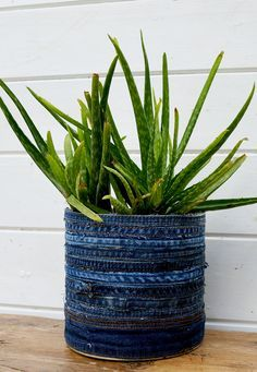 How to make a recycled jean planter from upcycled denim hems and seams and tin cans.