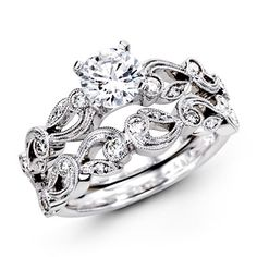 This gorgeous 18K white engagement ring and band is comprised of .28ctw round white Diamonds.    TR473