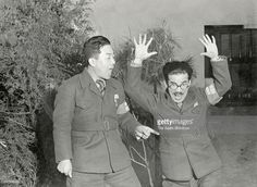 Comedians Yokoyama Entatsu and Sugiura Enosuke entertain the Japanese Imperial Army soldiers on Janaury 25, 1938 in Nanking, China. Yoshimoto Kogyo and the Asahi Shimbun formed 'Warawashi Tai', sent to Chinese warzones to entertain soldiers during the World War II.