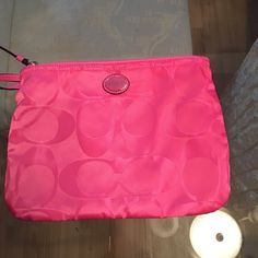 ✨ COACH POUCH✨ Daughter never used it with her tote. Brand new. Can be used as a cosmetic bag. Coach Bags Cosmetic Bags & Cases