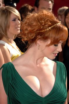Christina Hendricks... this woman is a goddess. - I do believe I found my hairstyle... but I want some more whisps hanging down the back