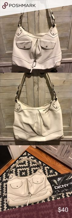 DKNY white leather bag DKNY white leather bag with dust cover. Spacious  bag with excellent interior and exterior pockets.  Some wear to leather as shown on bottom and strap, but overall white leather is in good shape. DKNY Bags Shoulder Bags