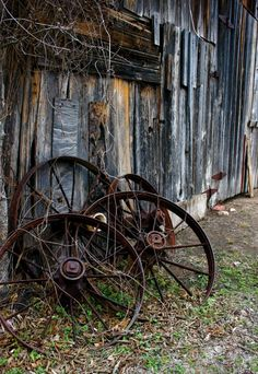 *THESE RUSTY WHEELS ROLL NO MORE ~ They just rest upon this old barn door!