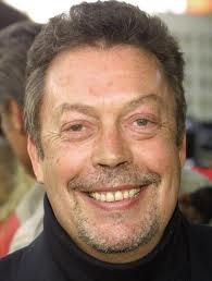 Tim Curry.  A fantastic and diverse actor.    http://en.wikipedia.org/wiki/Tim_Curry