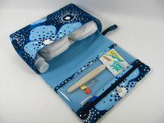 Idée chouette de pochette pour couches à glisser dans n'importe quel sac. J'aime. A améliorer.