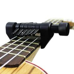 High Quality Black Flanger Flexi Portable Alternative Tuning Guitar Capo Support Various Tuning changing. A creative capo fits almost all the guitar fingerboards. 1 Tuning capo for guitar. Support various tuning changing without detune your guitar. Acoustic Guitar Lessons, Guitar Tips, Acoustic Guitars, Guitar Tuners, Learn To Play Guitar, Guitar Accessories, Guitar Strings, Playing Guitar, Learning Guitar