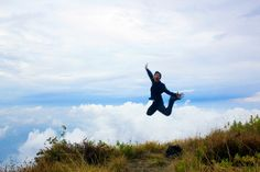 With the background of sea of clouds at top of Siti Ingghil, Putri Tidur Mountain 2.868 masl, East Java