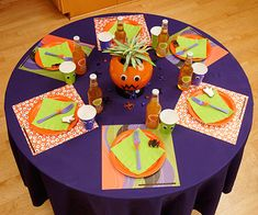 For the kids' table, start with a playful palette of bright purples, oranges, and greens for your table linens and partyware: http://www.bhg.com/halloween/parties/mod-halloween-party/?socsrc=bhgpin092614frightfullyfunkidstable&page=2