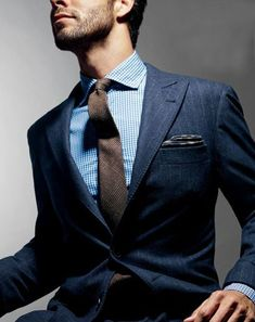Shop this look for $104:  http://lookastic.com/men/looks/white-and-blue-dress-shirt-and-charcoal-pocket-square-and-navy-blazer-and-brown-tie/651  — White and Blue Dress Shirt  — Charcoal Pocket Square  — Navy Vertical Striped Blazer  — Brown Plaid Wool Tie