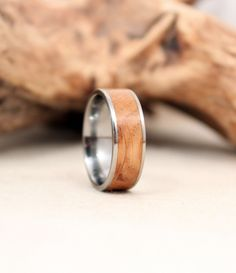 Jack Daniels American White Oak and Titanium Ring Wood Ring. $205.00, via Etsy.