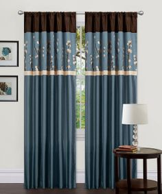 Add an element of elegance to décor and adorn a window with this classic curtain set. With exquisite floral embroidery alongside faux silk, these stylish treatments feature conveniently built-in pockets that easily slide onto a rod for quick installation.