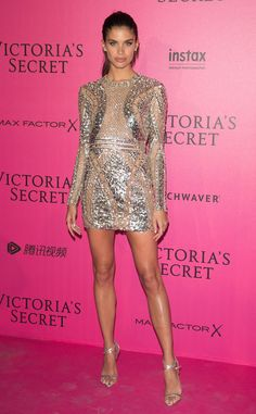 Sara Sampaio from Victoria's Secret Fashion Show 2016 Pink Carpet Arrivals  The brunette beauty sparkled in a metallic cocktail dress with sheer accents.