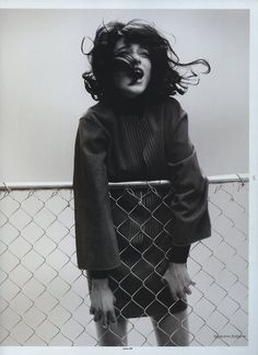 black and white // photograph // girl // wind // fence