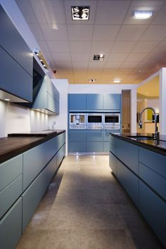 Schuller handle free kitchen matt lacquer blue grey
