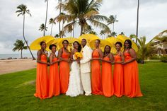 Blushing Bride Lachelle Robinson with her husband Larry and her colorful bridesmaids! Lachelle and Larry decided to celebrate their union at the Rio Grande in San Juan Puerto Rico. Photography: Taun Henderson