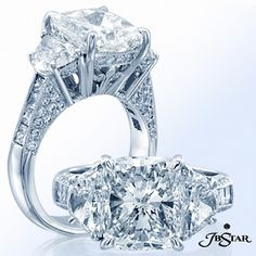 An exquisite 3-stone signature engagement ring featuring a cushion diamond center with half moon sides and princess and pavé accents. Stunning in pure platinum!