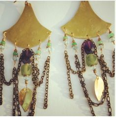 """Enchanted Archways Arching hammered brass lines mirror the archways often seen in traditional Vedic architecture, while dripping brass chain gives movement, fluidity and opulence. A rich assortment of faceted amethyst, Afghani jade, aquamarine and chrysoprase truly decorate these ear adornments. 14kt GF ear wires and findings. Hangs 5""""."""